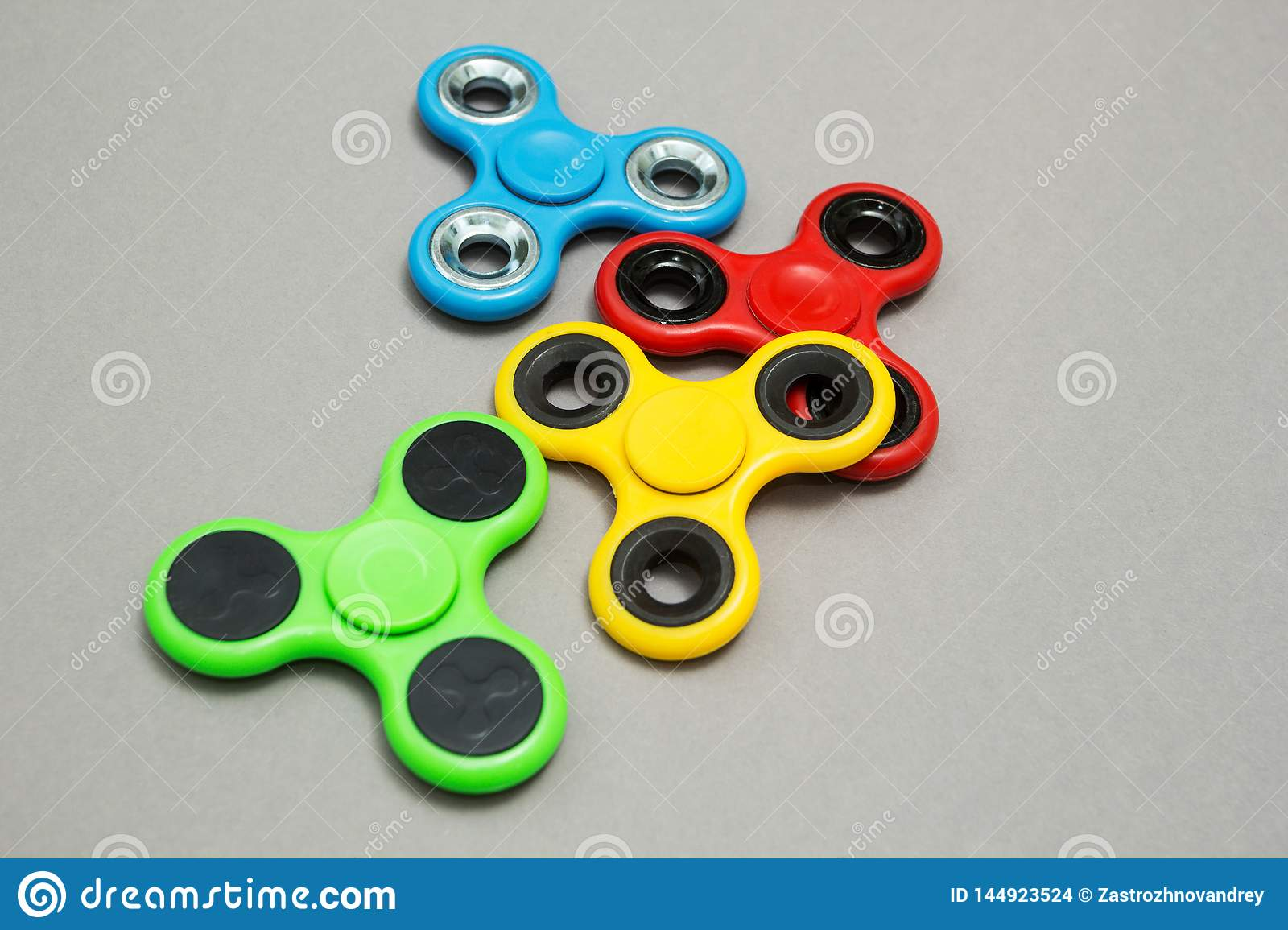 Multi Colored fidget finger spinner stress on grey background