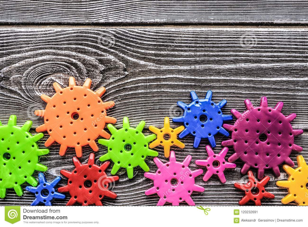 Multi-colored gears on the background