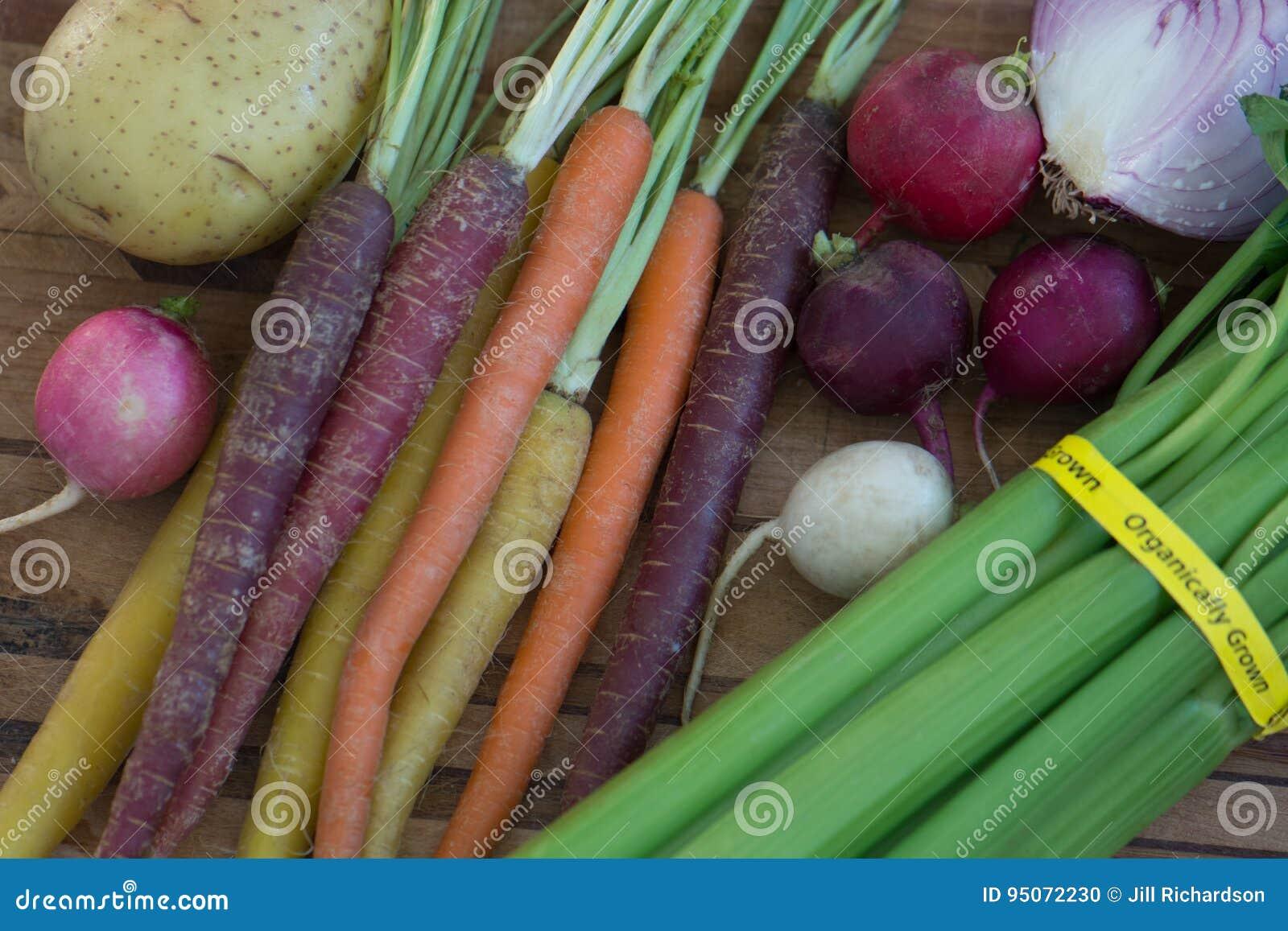 Multi Colored Organic Carrots With Potato Onion Celery