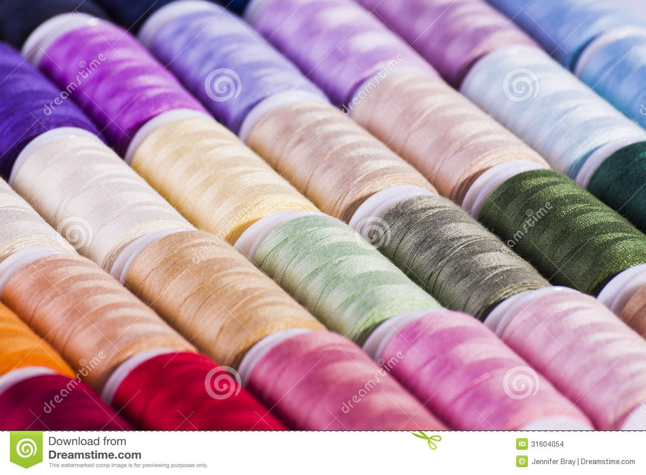 Multi coloured cotton reels arts and crafts background for Arts and crafts industry