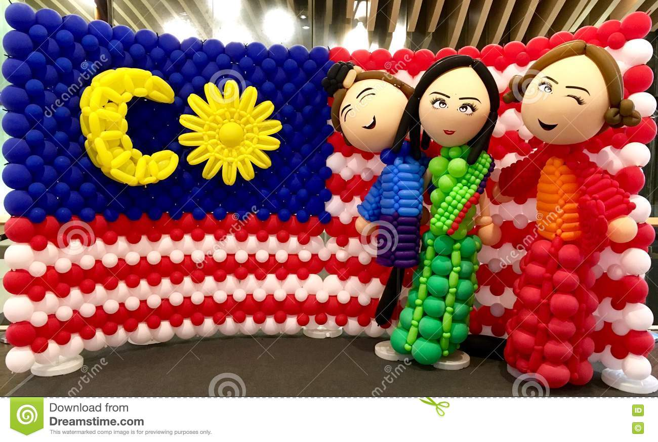 Multi cultural Malaysian with flag behind
