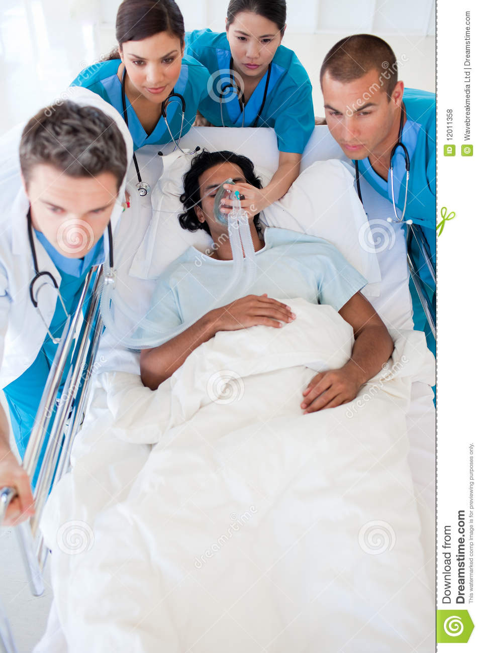 Multi-ethnic emergency team carrying a patient