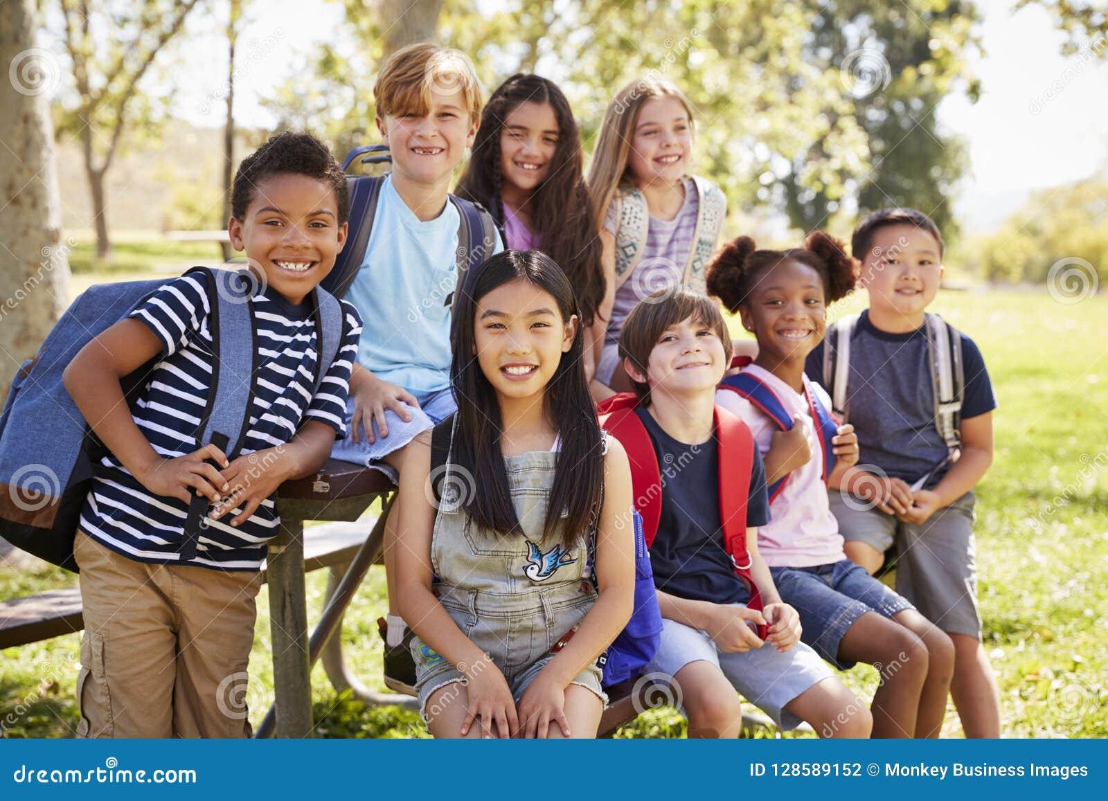 Multi-ethnic group of schoolchildren on school trip, close up