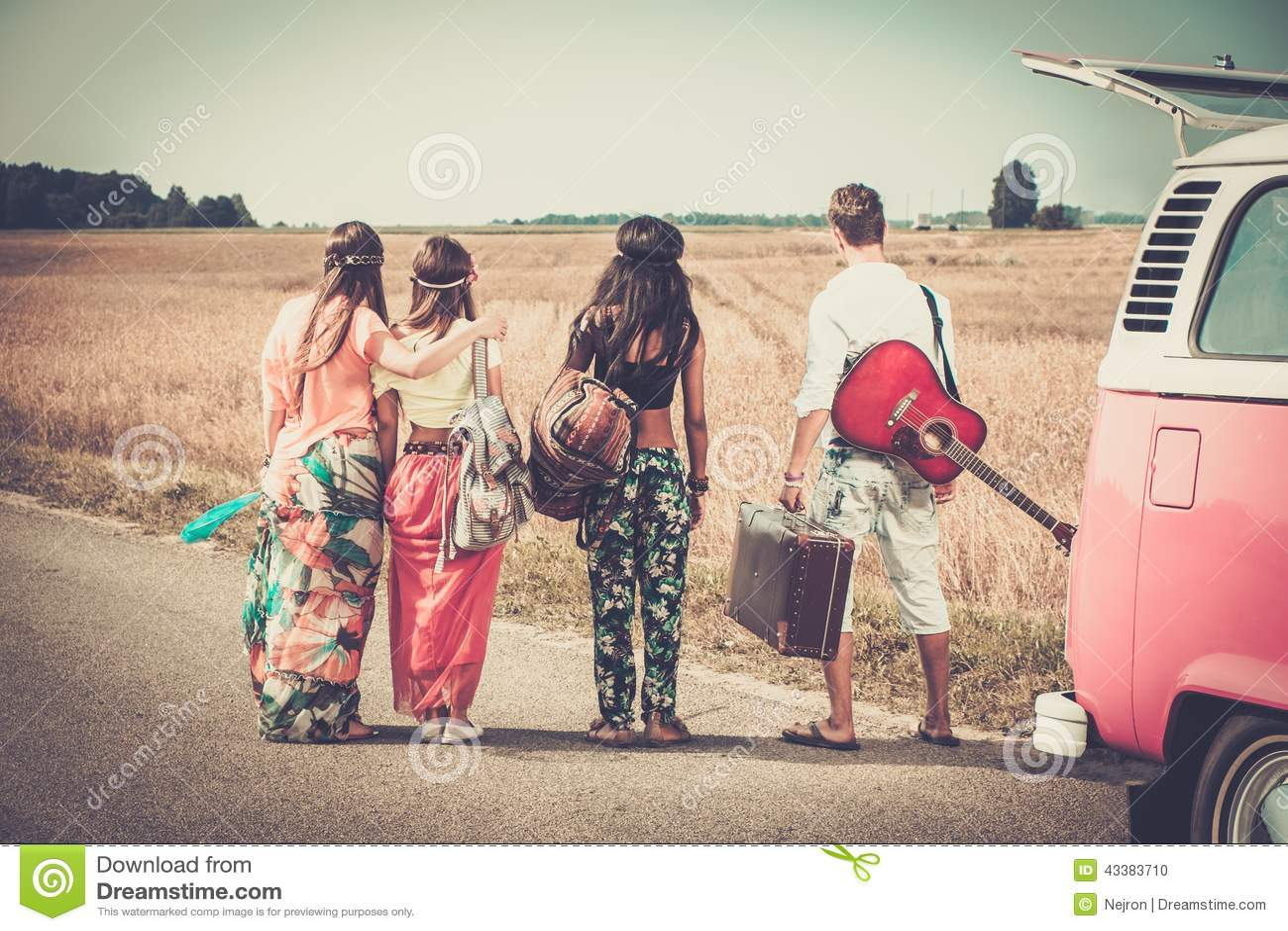 Multi Ethnic Hippie Friends On A Road Trip