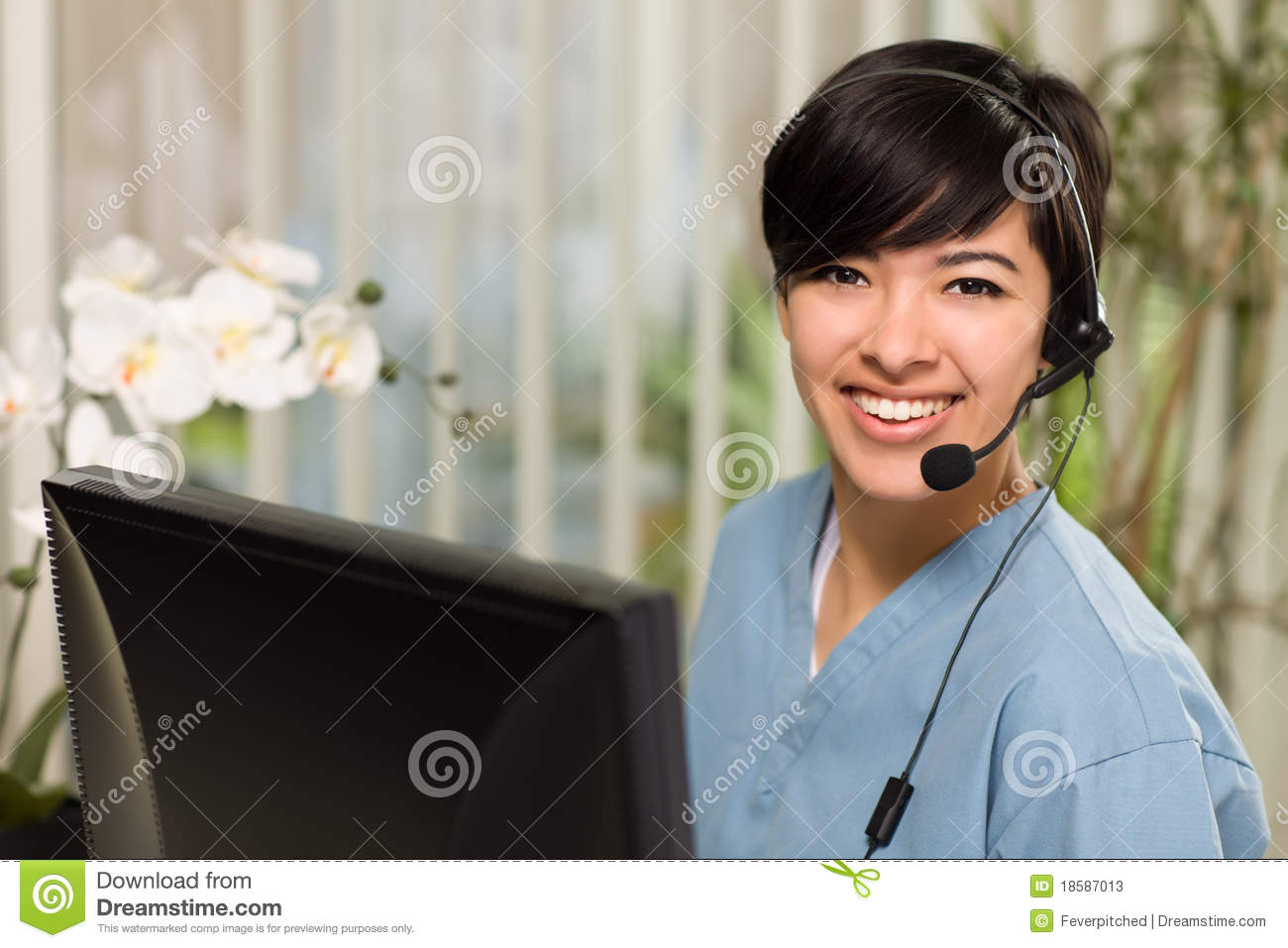 Multi-ethnic Young Woman With Headset and Scrubs