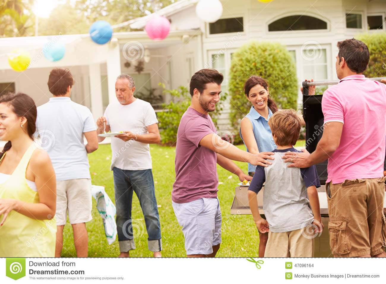 multi generation family enjoying party garden together 47096164