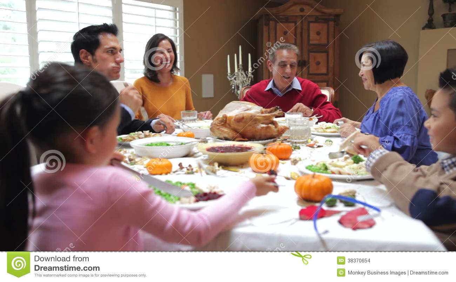 Multi Generation Family Enjoying Thanksgiving Meal Stock Footage