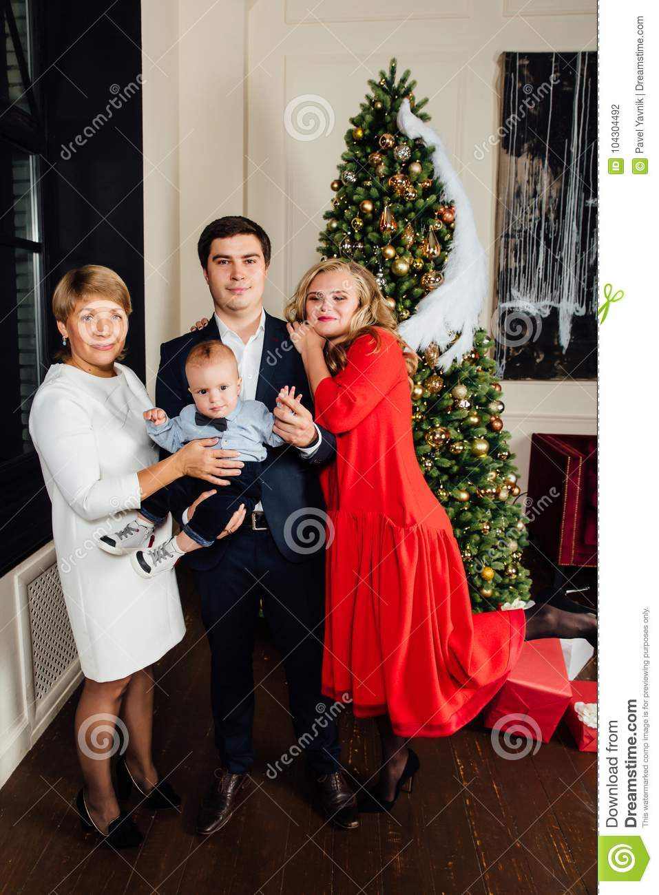 Multi Generation Family Group Portrait On A Christmas Tree