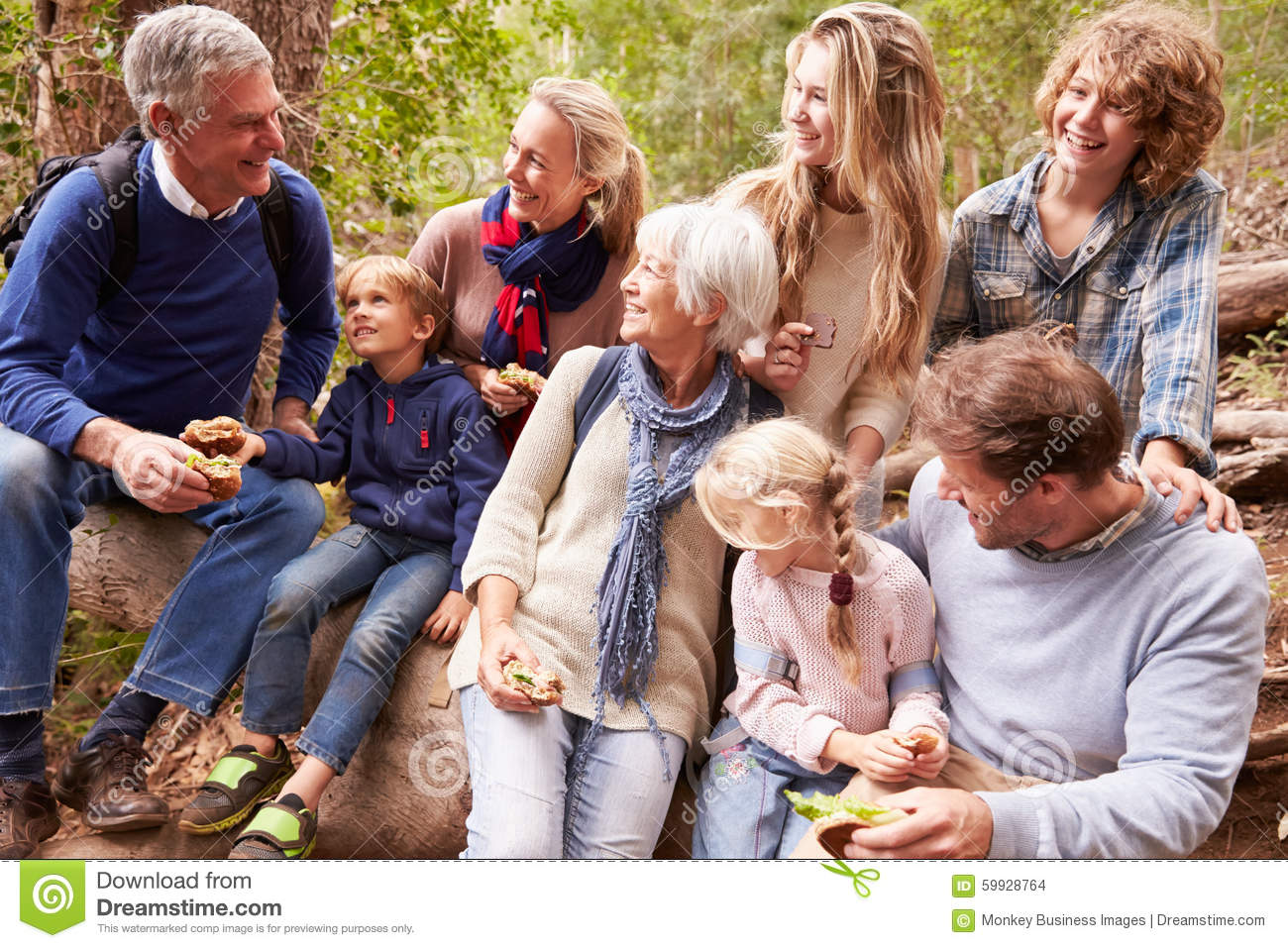 Multi-generation family with teens eating outdoors together