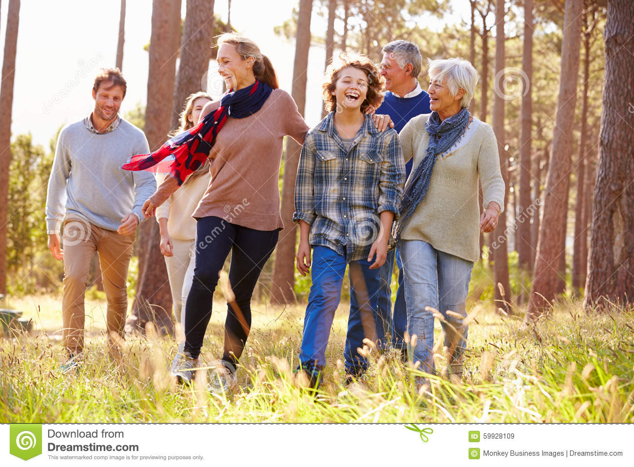 Multi-generation family with teens walking in countryside