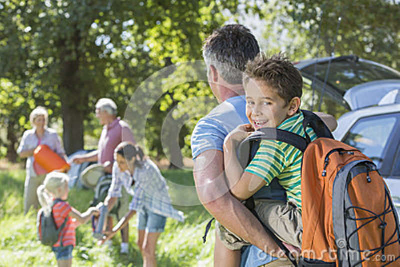 multi generation family unpacking car on camping trip stock photo image of hands walking. Black Bedroom Furniture Sets. Home Design Ideas