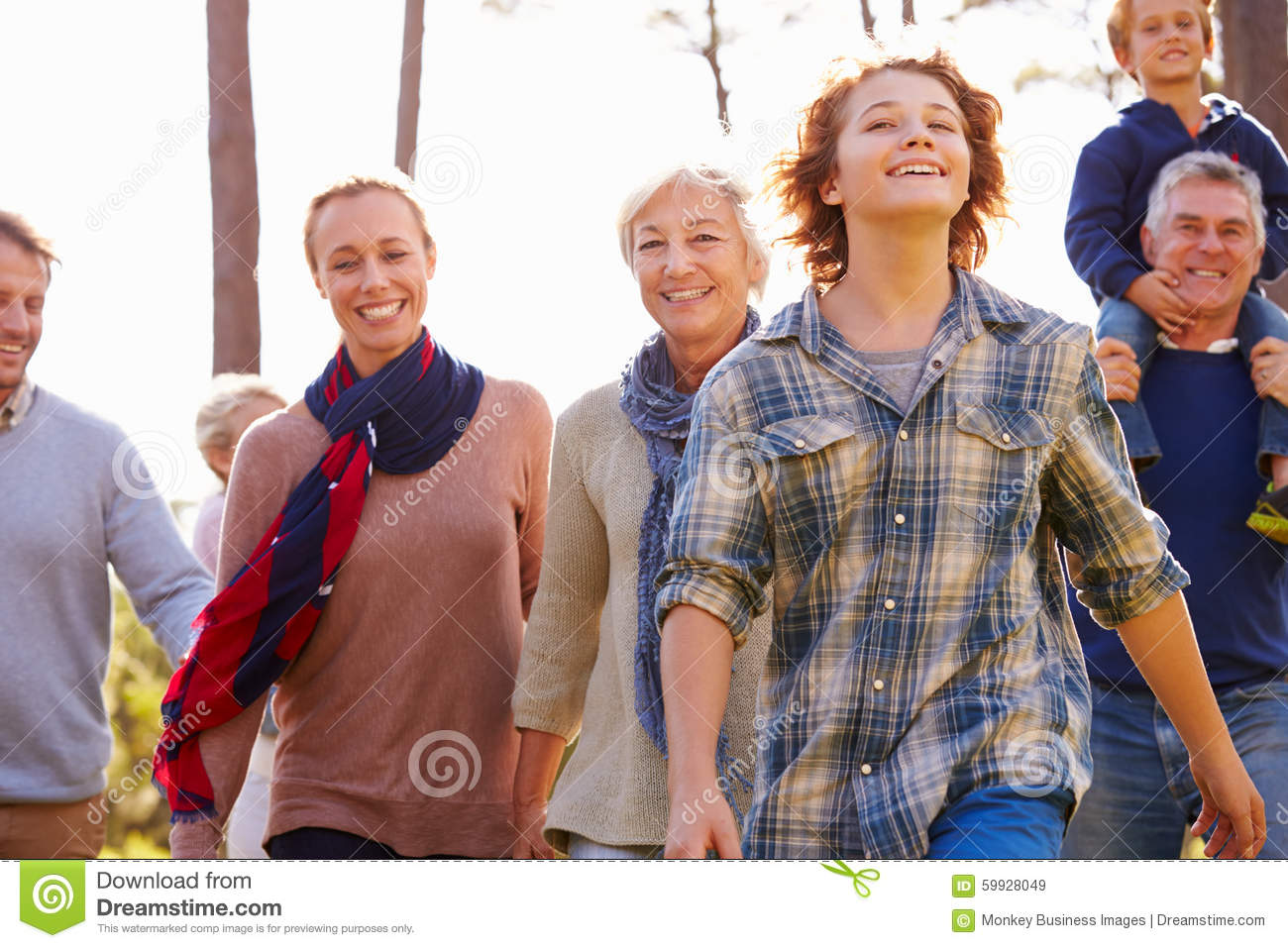 Multi-generation family walking in countryside, close up