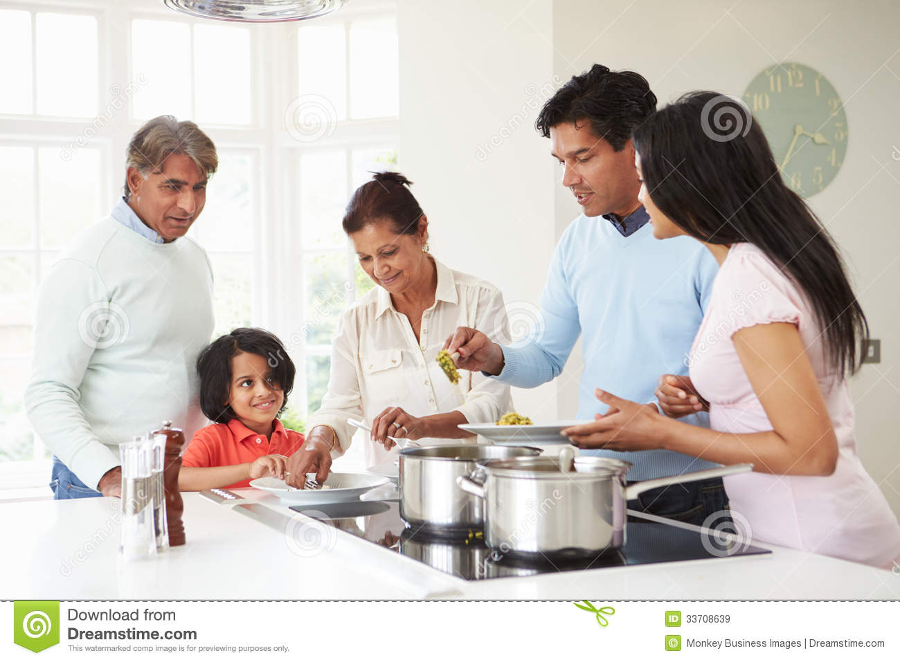 Family cooking kitchen - Multi Generation Indian Family Cooking Meal At Home Royalty Free Stock Images