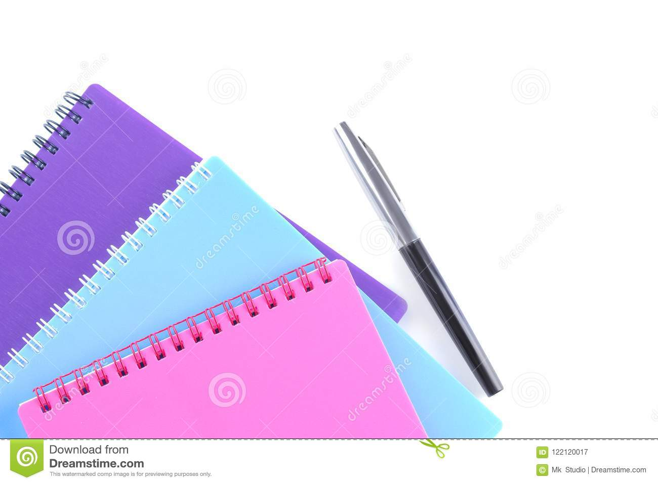 exercise book and pen on white isolated background. View from above. School supplies