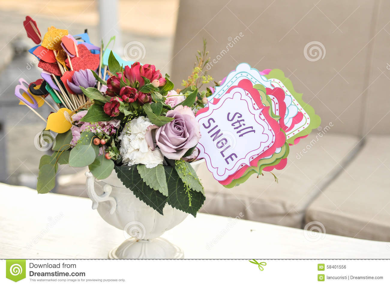 Multicolored Fresh Flowers Bouquet And Paper Decorations In A Vase