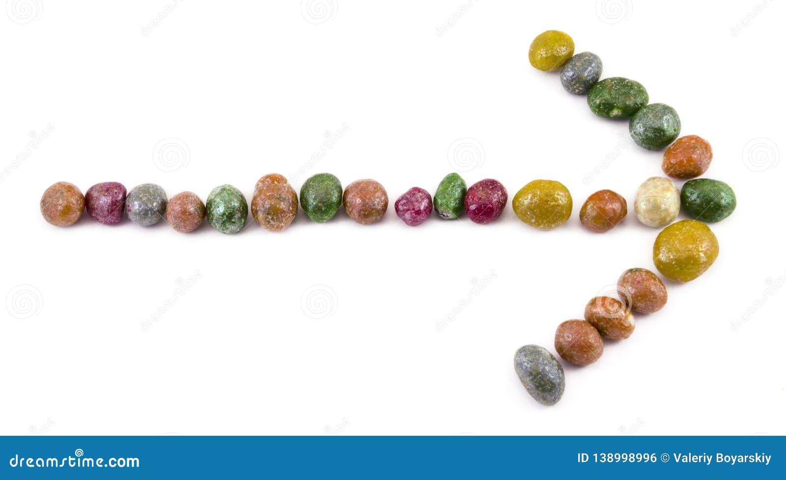 Multicolored glazed raisins on a white background