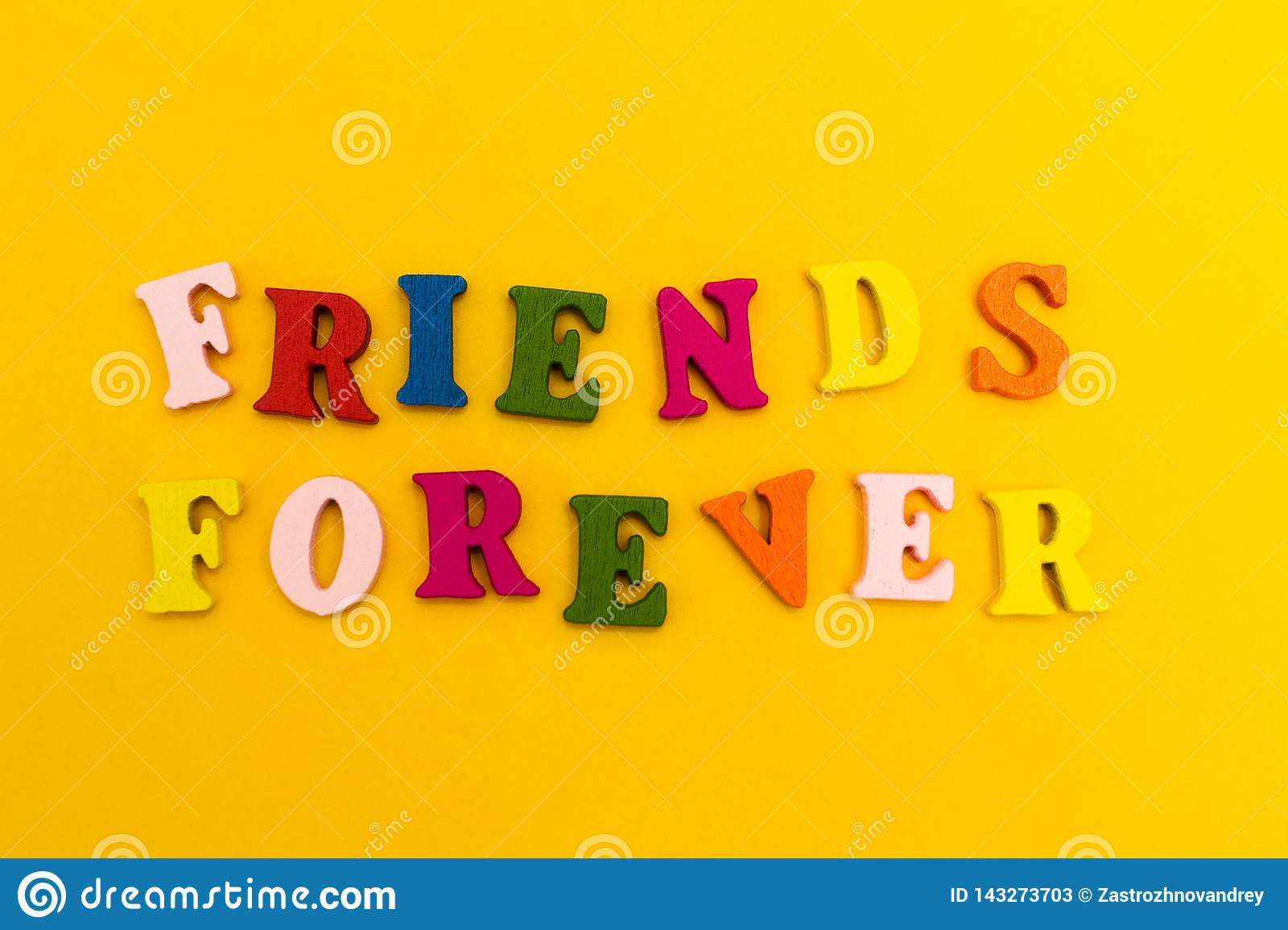 Multicolored letters on a yellow background. Friends forever