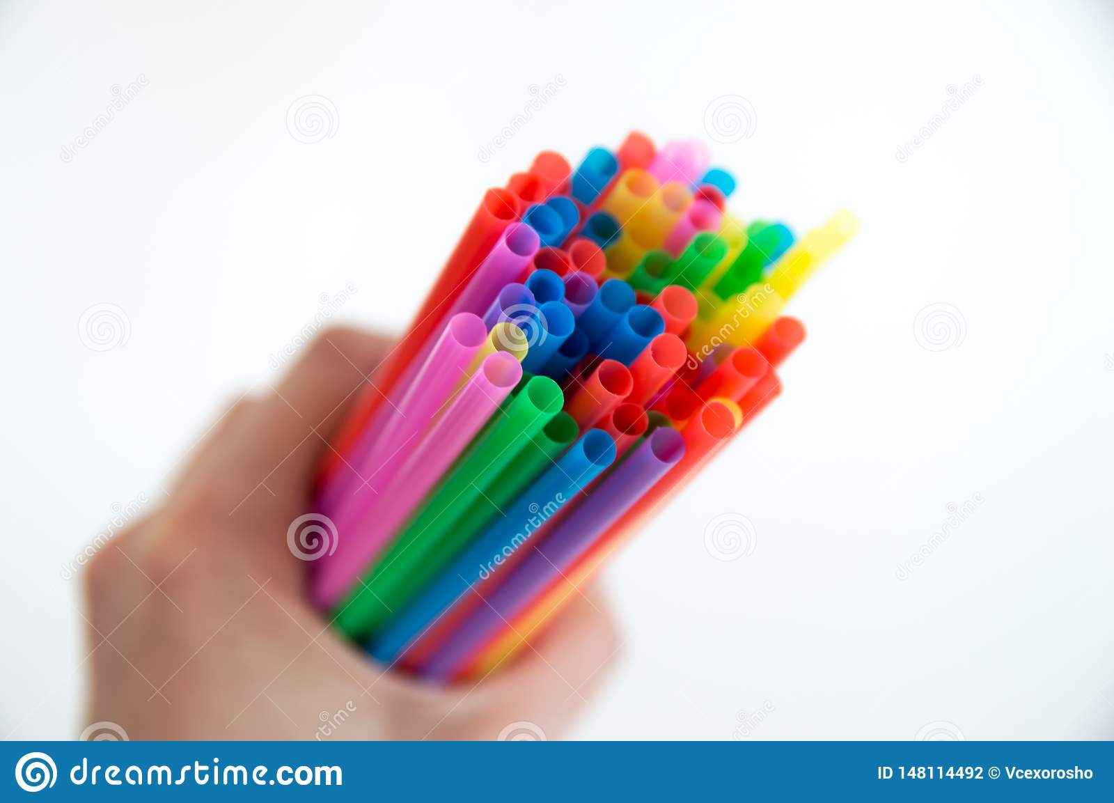 Colored wooden pencils for drawing in a glass stand on a white background. Children`s multi-colored pencils for drawing