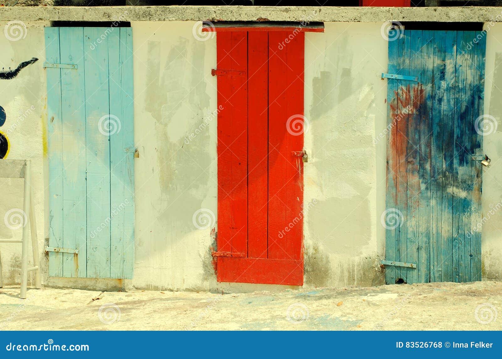 Multicolored run-down doors