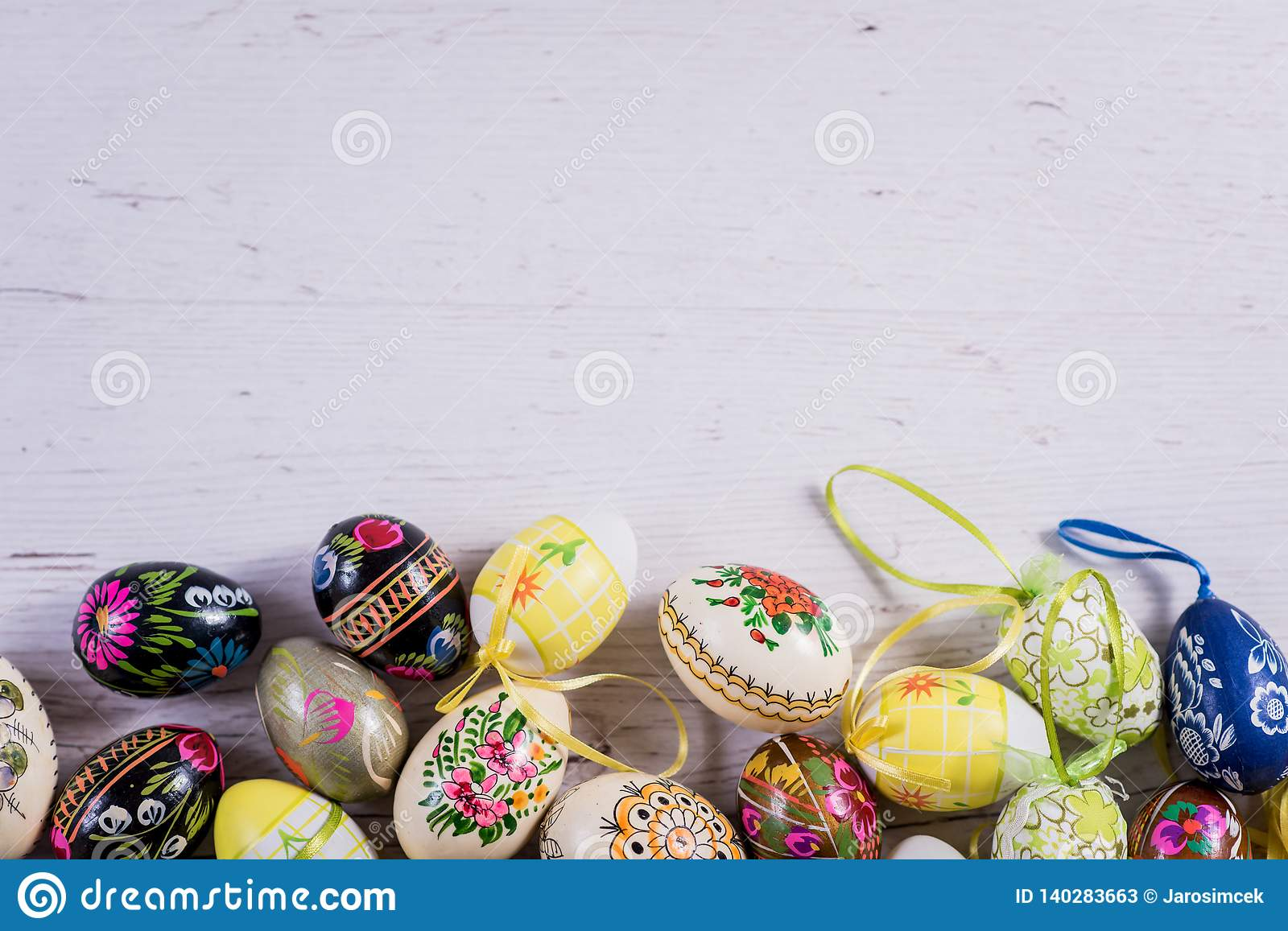 Multicolored spring tulips and Easter eggs with decorations