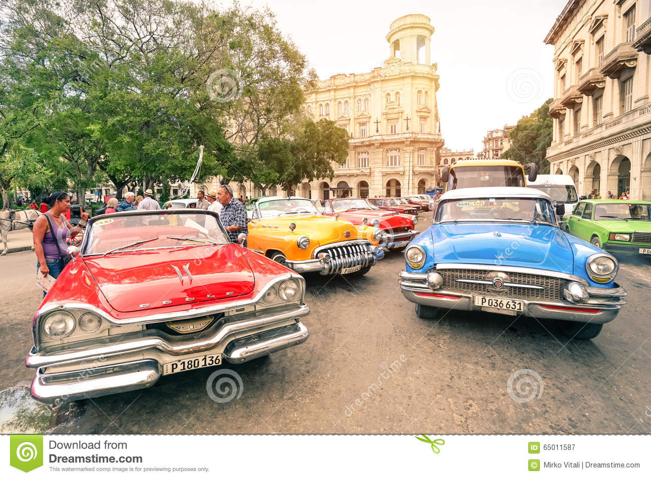 multicolored vintage american cars in havana city editorial photography image 65011587. Black Bedroom Furniture Sets. Home Design Ideas