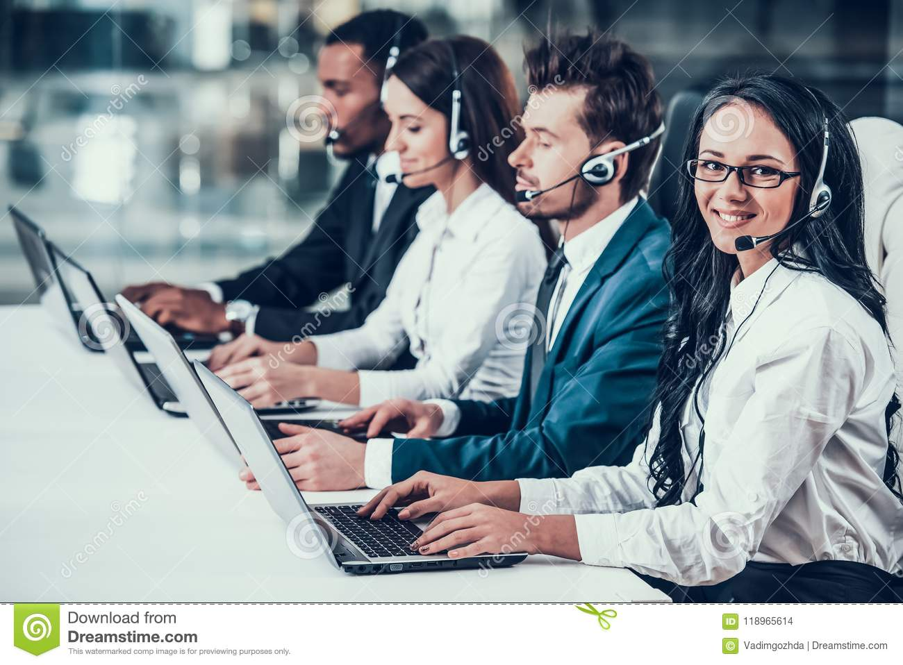 Multicultural Young Happy Employees In Call Center Stock