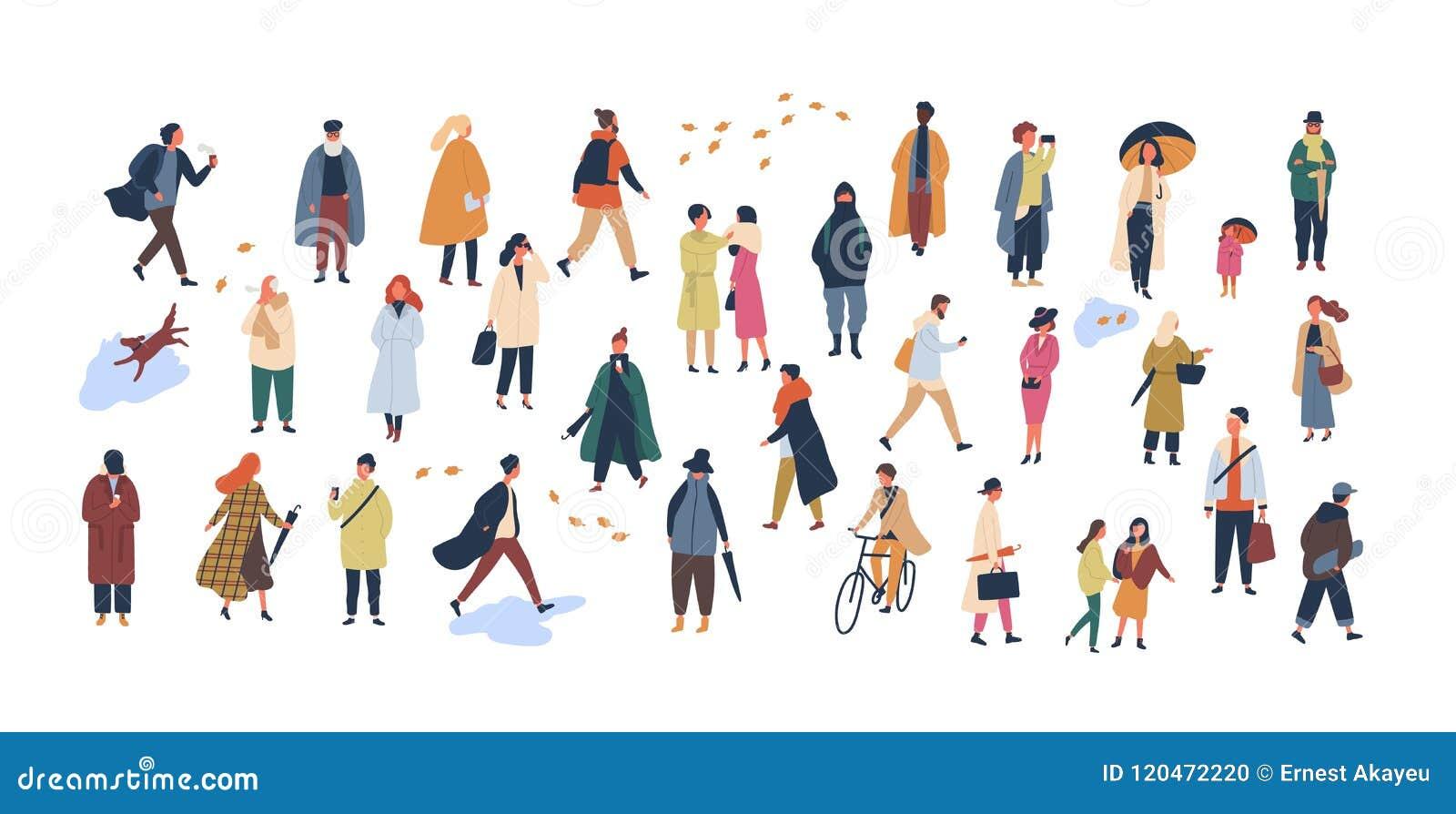 A multidão de povos minúsculos vestiu-se na roupa ou no vestuário do outono que andam na rua e que executam atividades exteriores