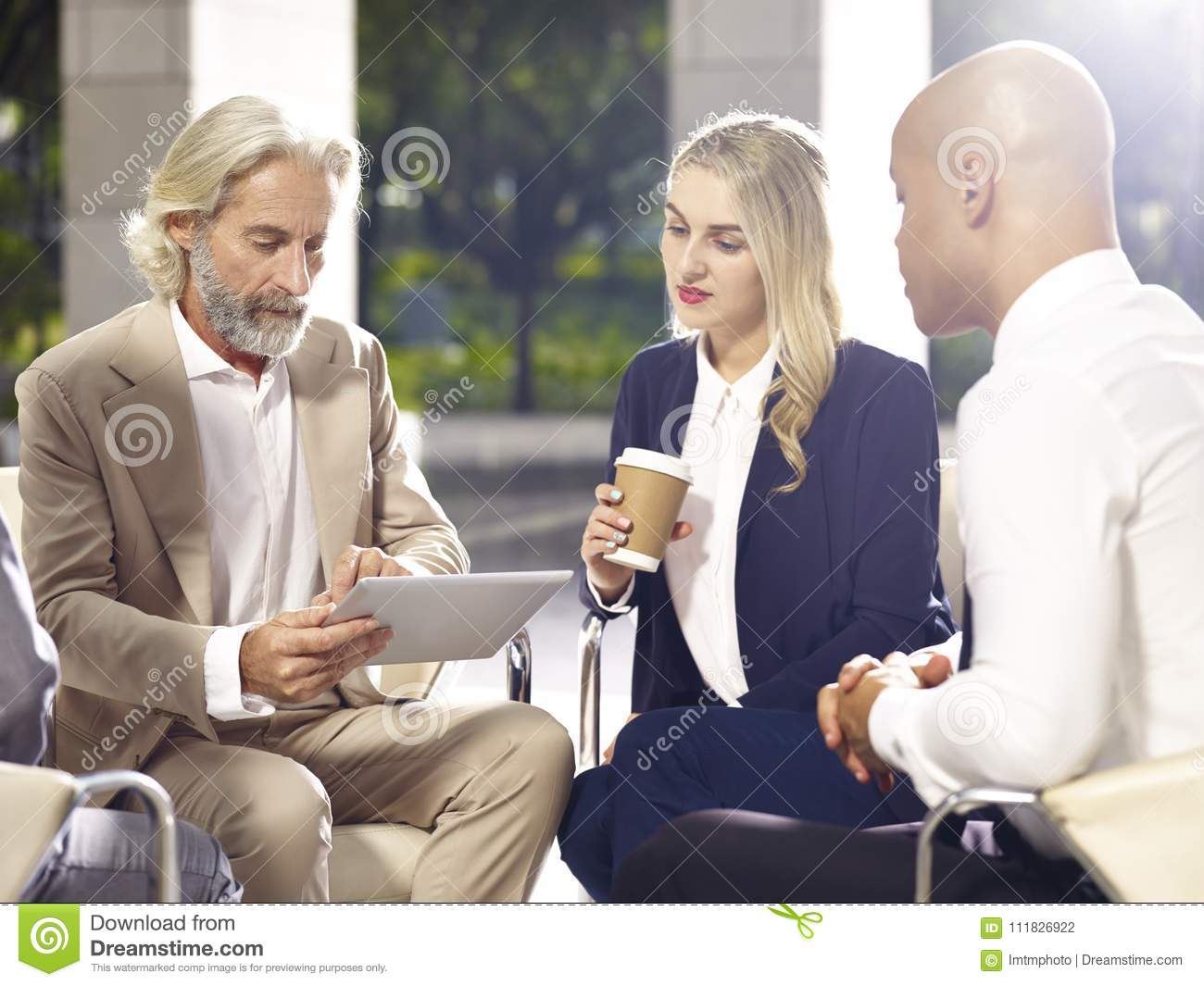 Corporate executives meeting discussing business in modern build
