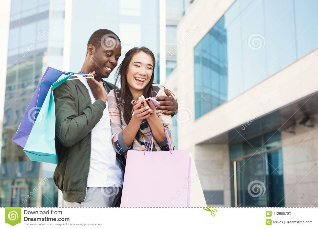 Multiethnic couple shopping together