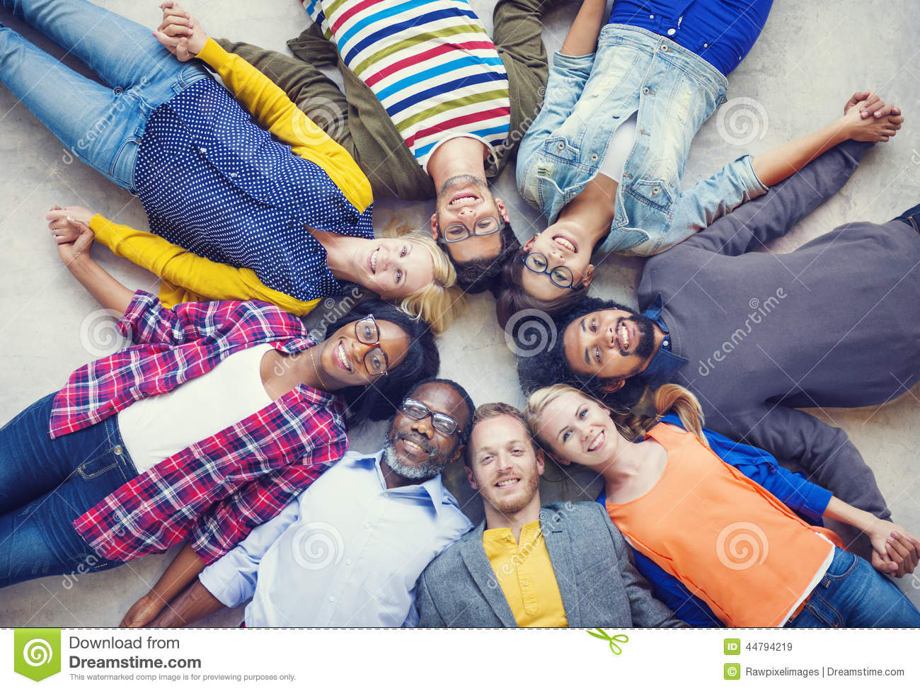 Multiethnic People Holding Hands and Lying Down