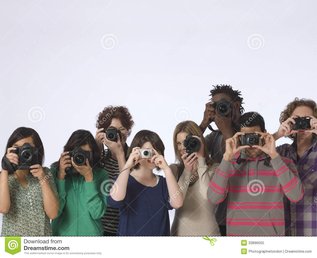 ... of multiethnic people taking photos straight at the camera in studio