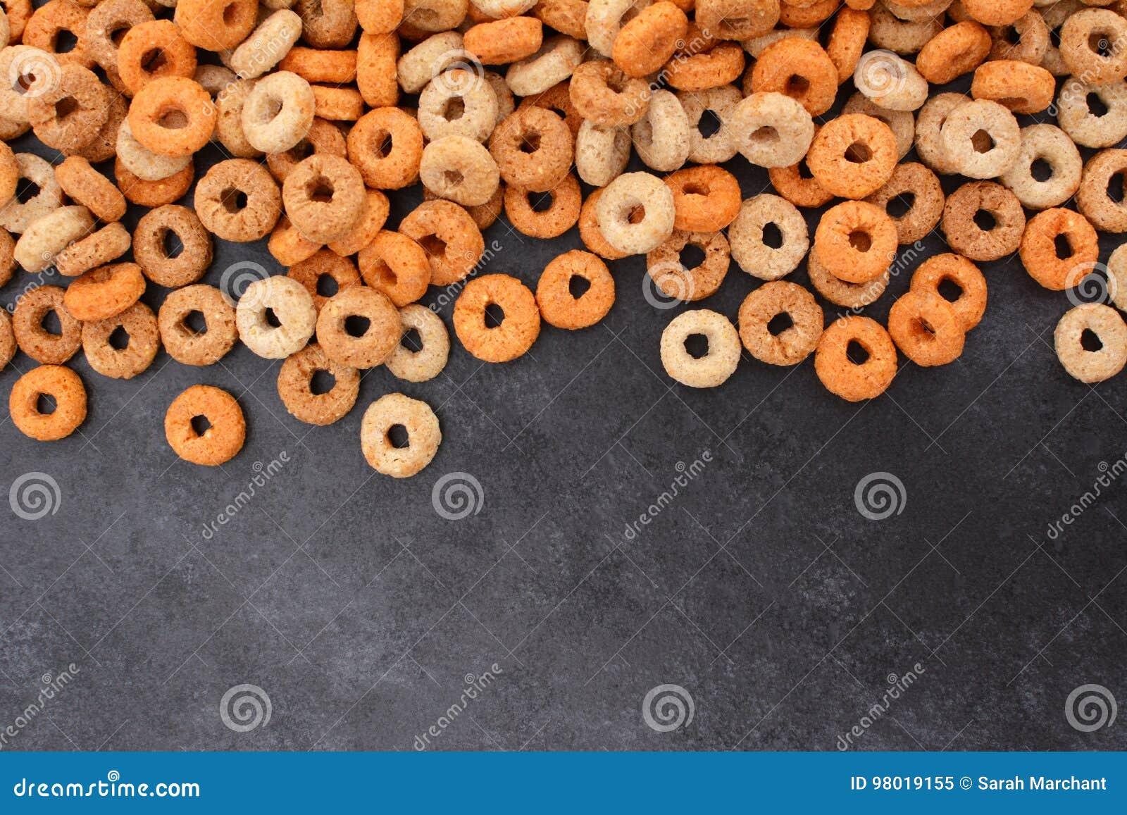 Multigrain hoops breakfast cereal border on dark grey slate