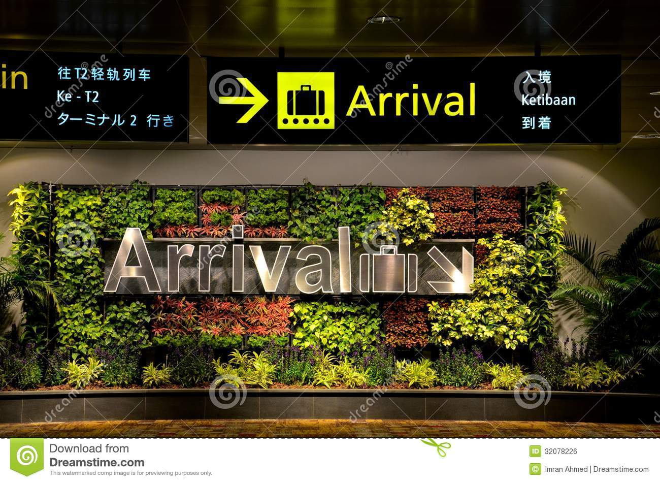 multilingual arrival sign and flowers at airport editorial. Black Bedroom Furniture Sets. Home Design Ideas