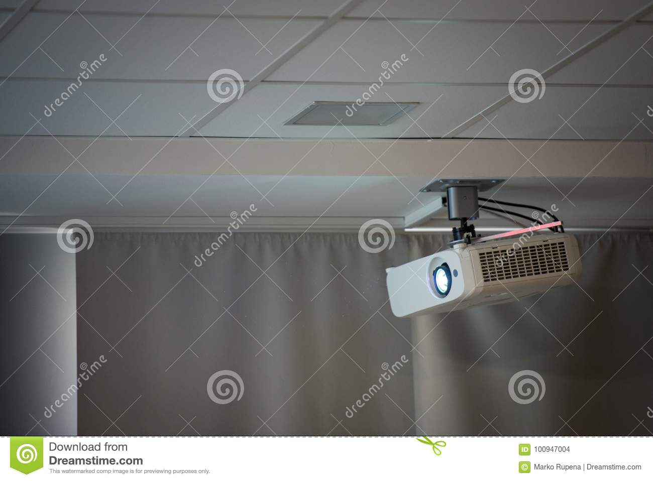 Multimedia projector on the ceiling of conference room