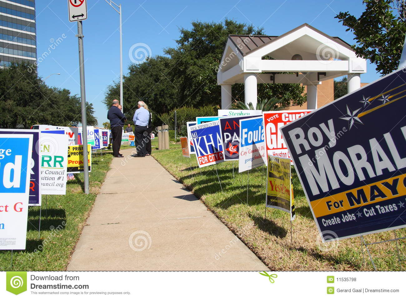 Multiple campaign signs with voters