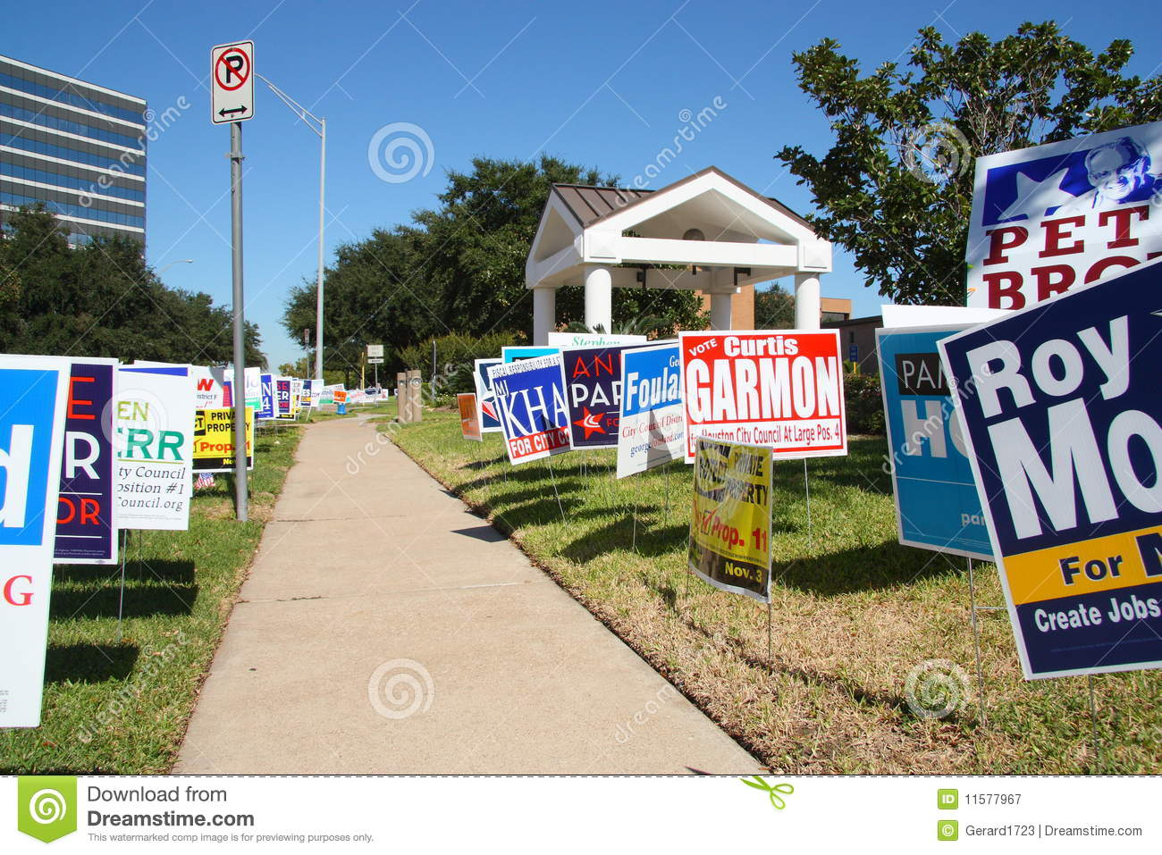 Multiple campaign signs at voting location