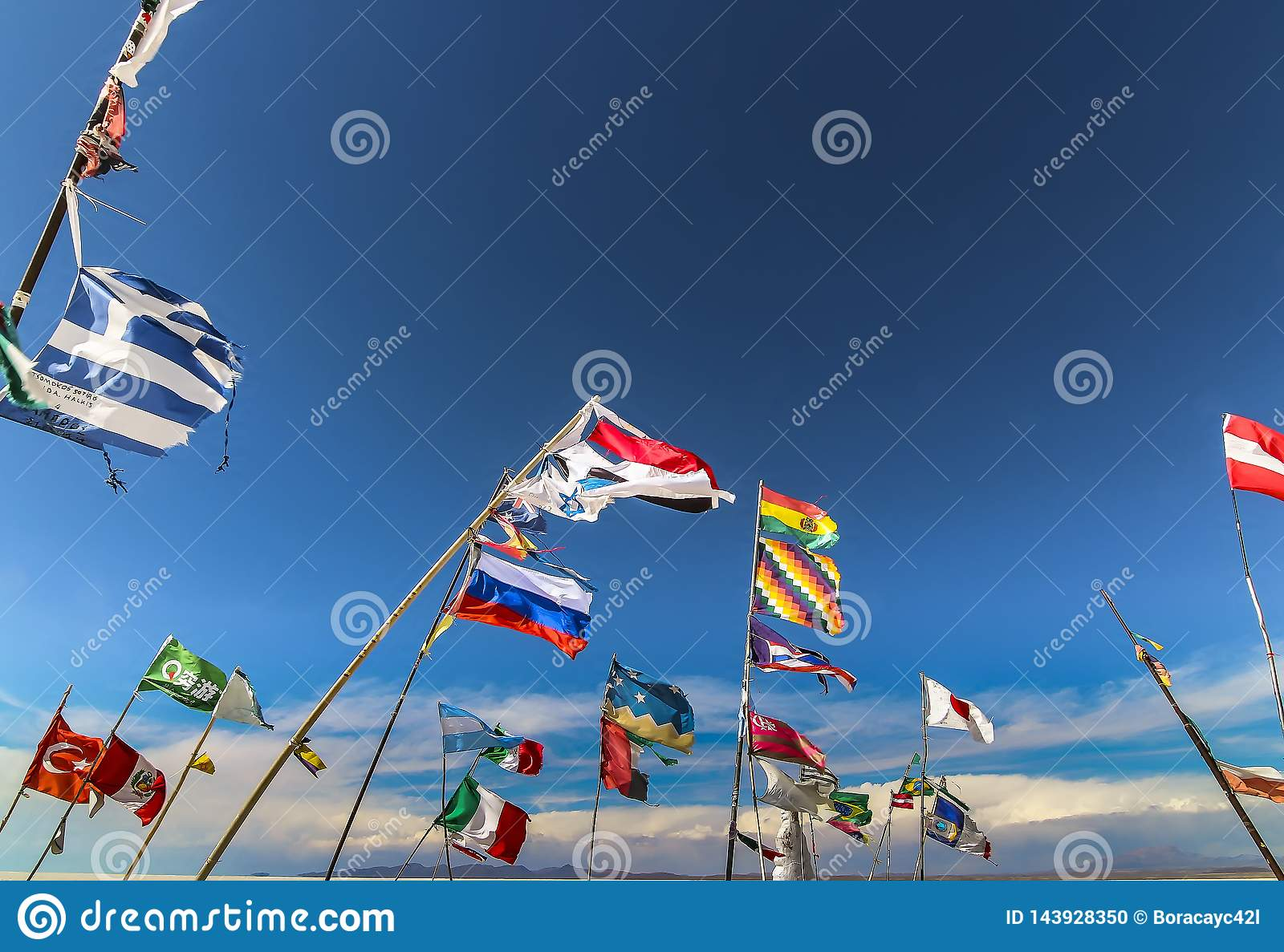 Multiple country flags against the wind at Plaza de las Banderas Uyuni
