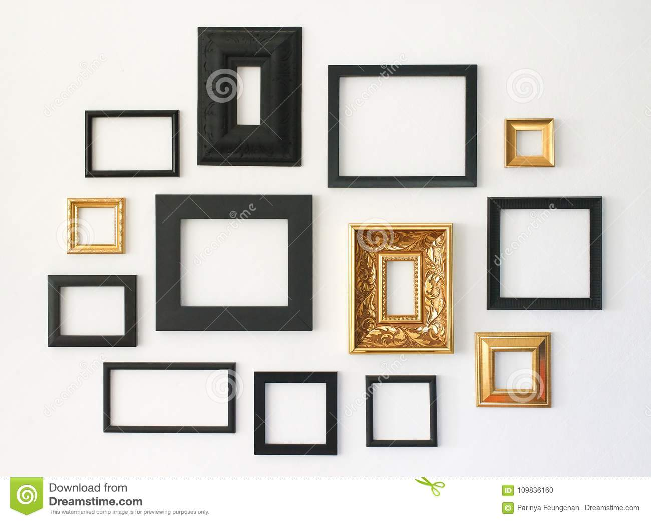 multiple many blank small picture frames on white wall. Black Bedroom Furniture Sets. Home Design Ideas