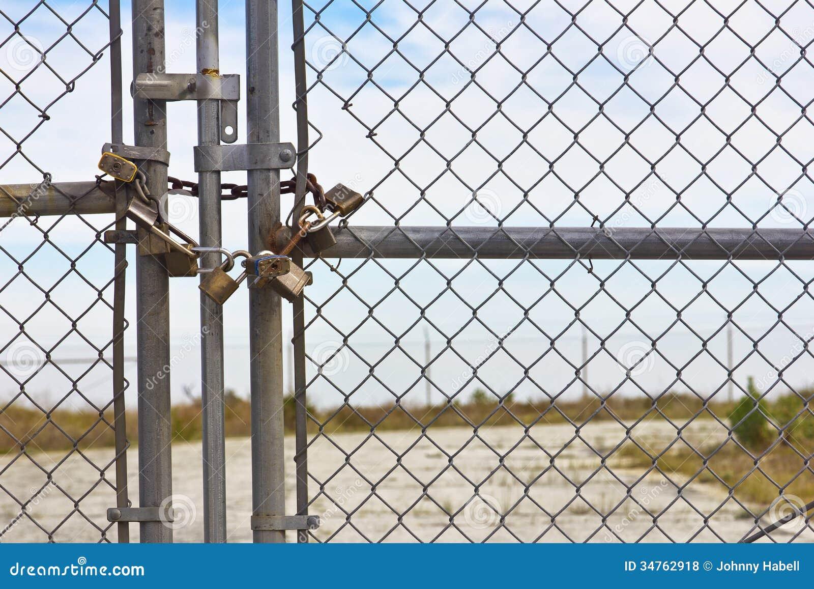 Multiple pad locks stock photo image of cage