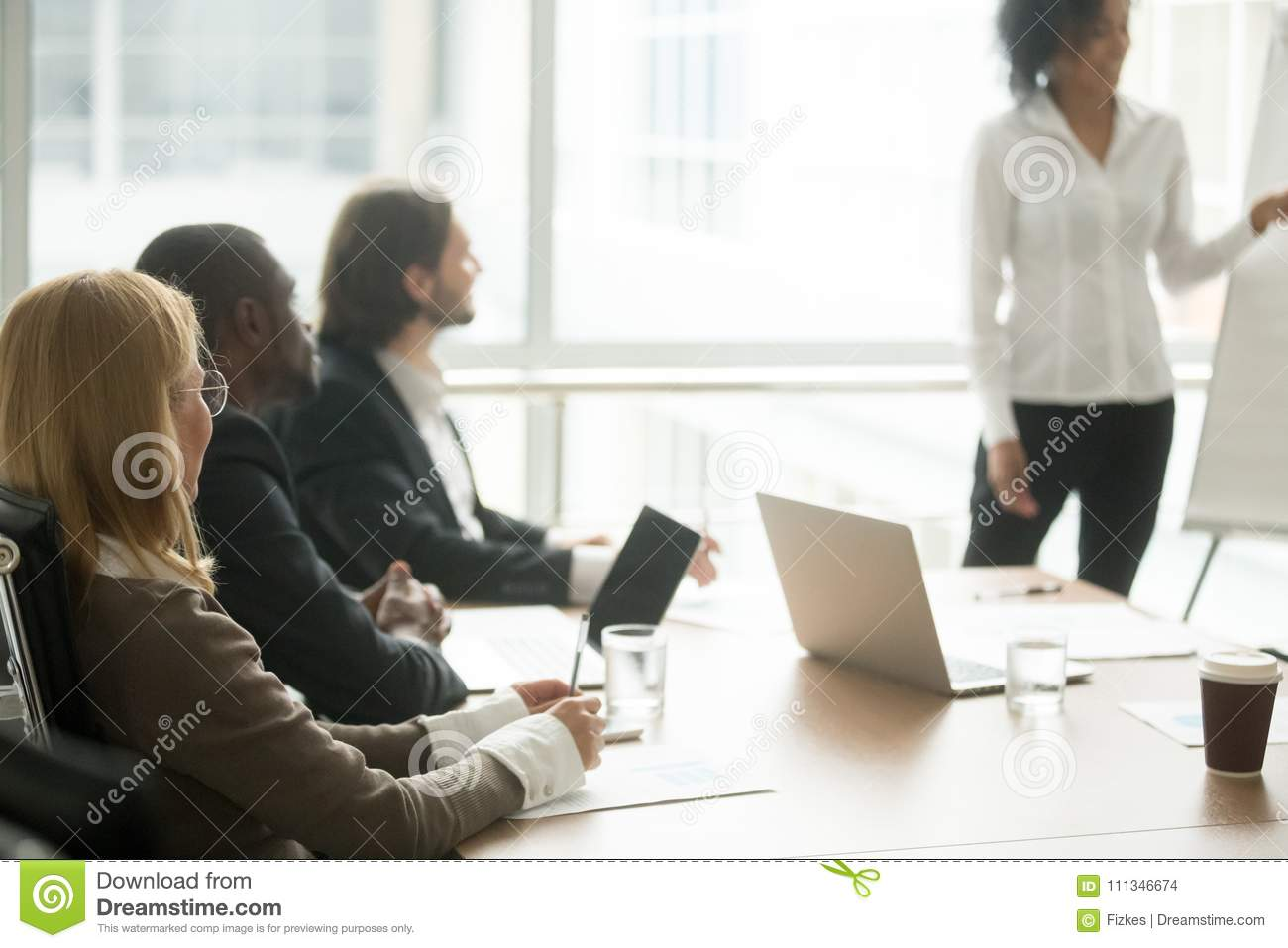 Multiracial businesspeople attending corporate group training or