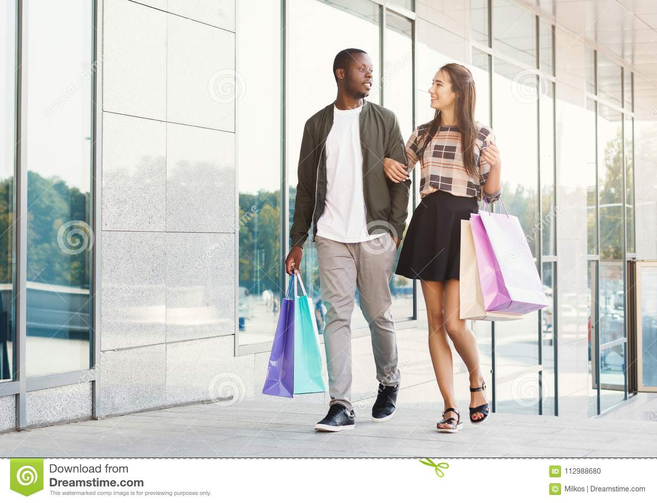 Multiracial couple shopping together