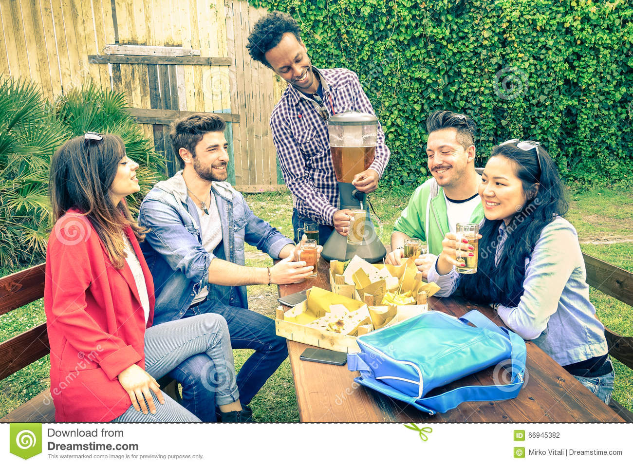 Friends Enjoying Barbecue Garden Stock Photos, Images, & Pictures ...