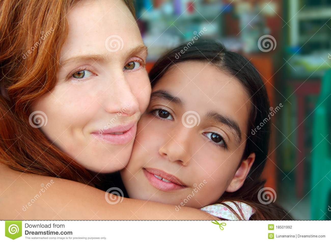 Multiracial mother and daughter family hug