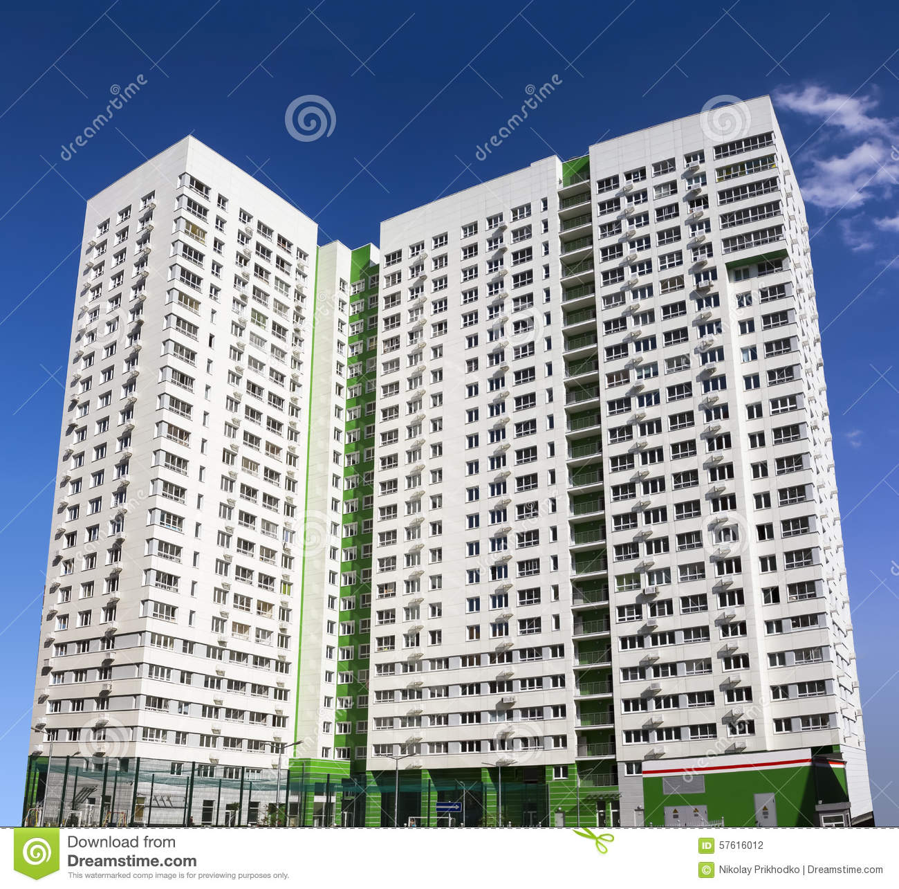 Apartment Block: Multistory New Modern Apartment Building Against The Blue