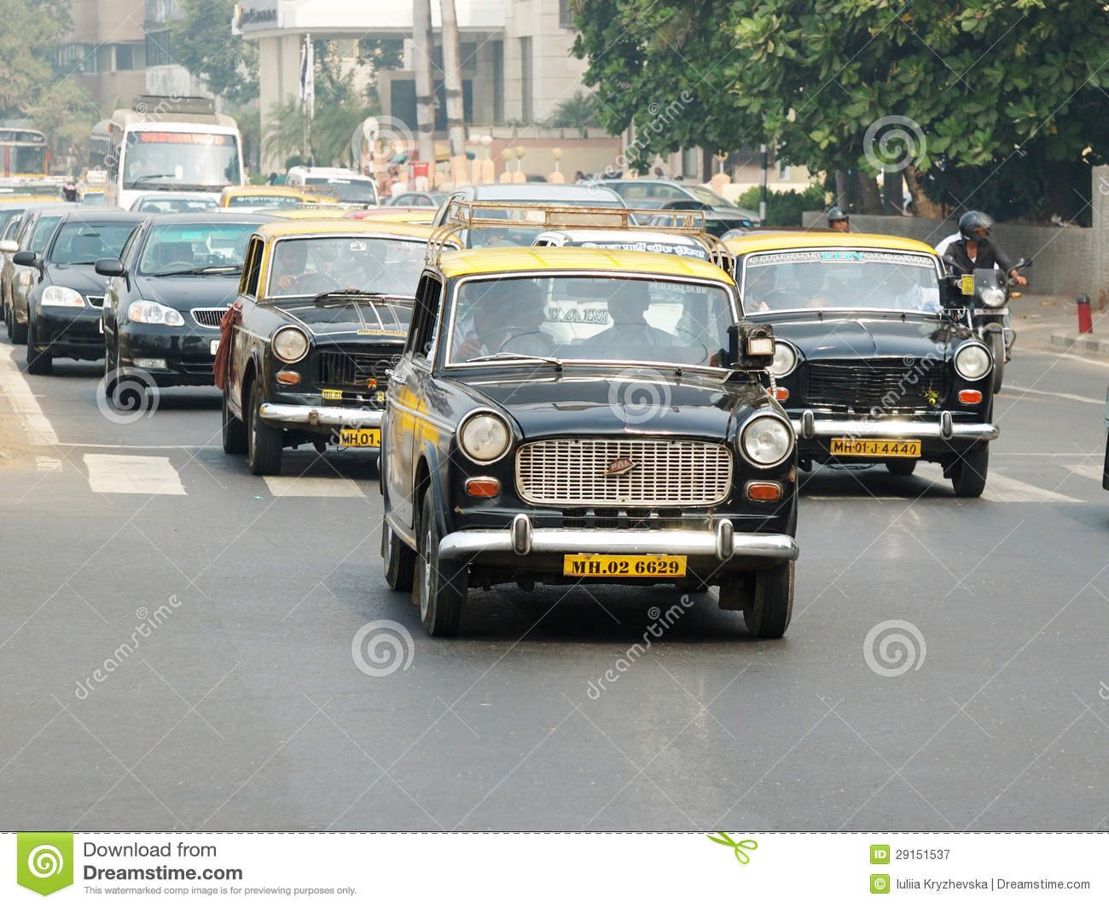 Mumbai traffic with several classical ambassador cabs,India