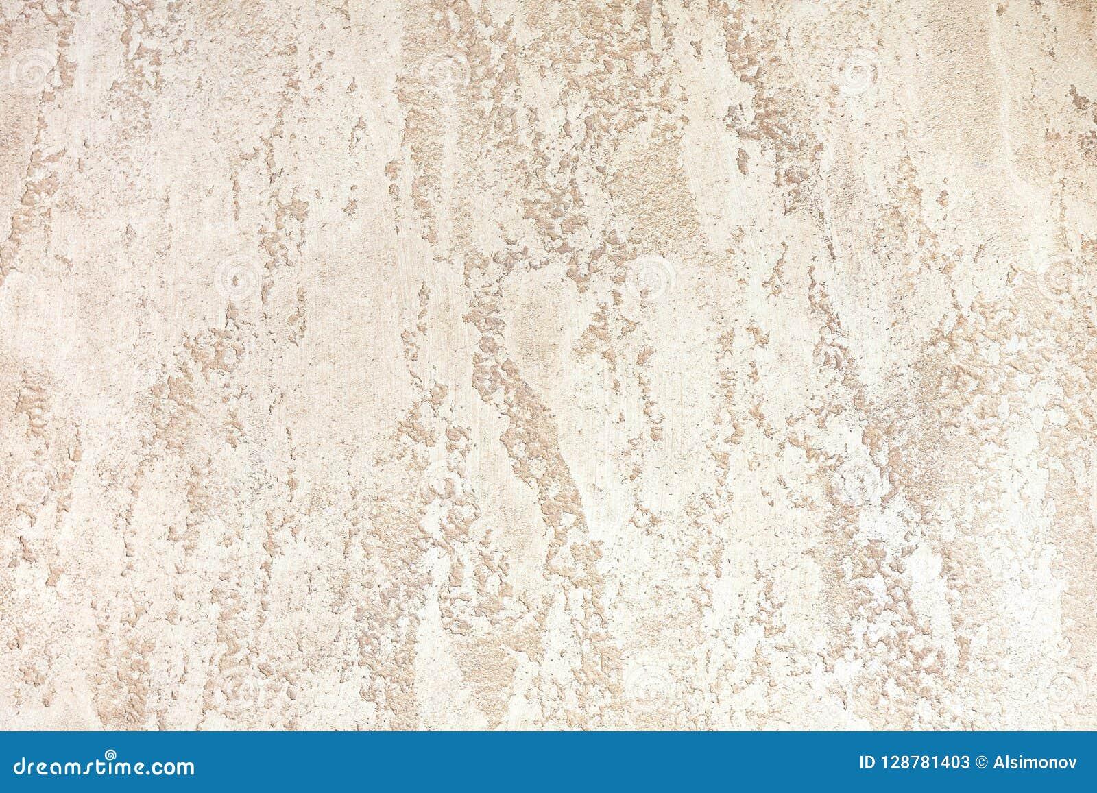 Mur avec le plâtre décoratif de couleur brun clair milieux texturisés