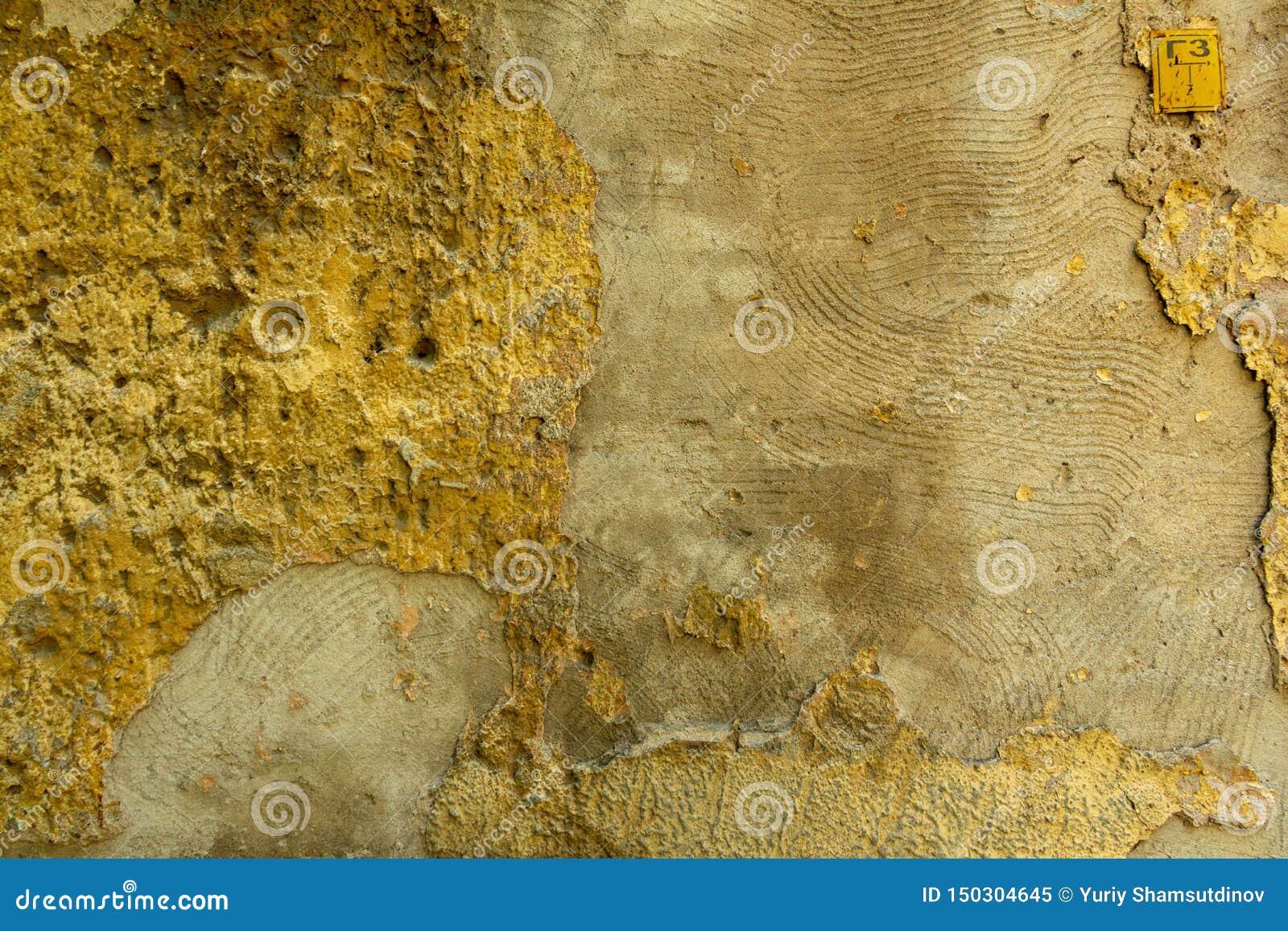 Mur de béton et de brique avec la texture de plâtre