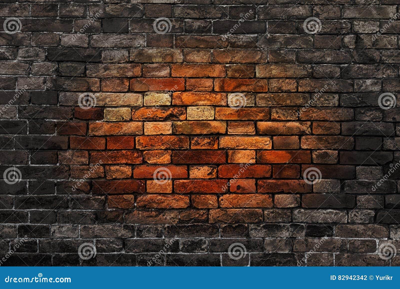 Mur de briques avec la tache rougeâtre ovale
