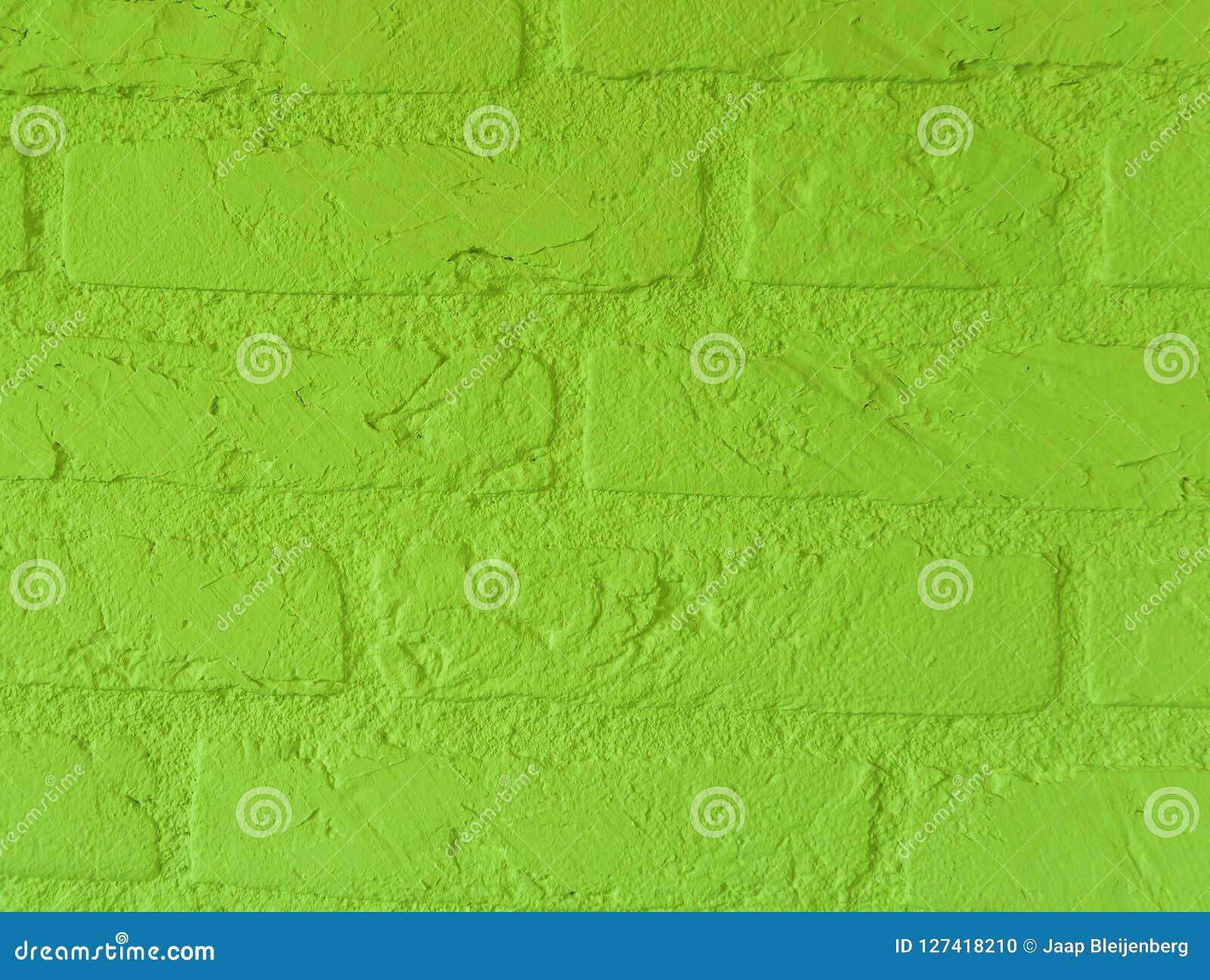 Mur de briques en pierre vert vibrant moderne de chaux avec de grandes briques étroites vers le haut du modèle de fond de cru