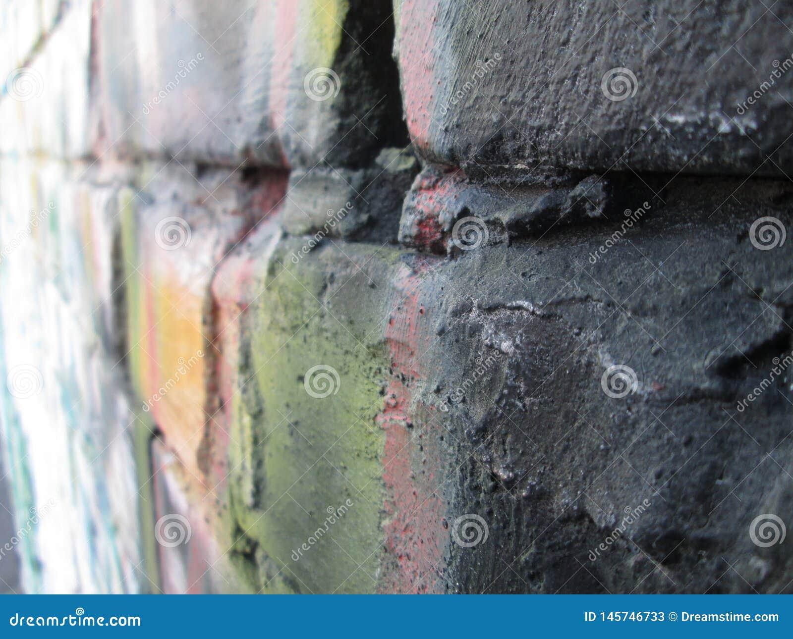 Mur de briques de graffiti ; briques colorées